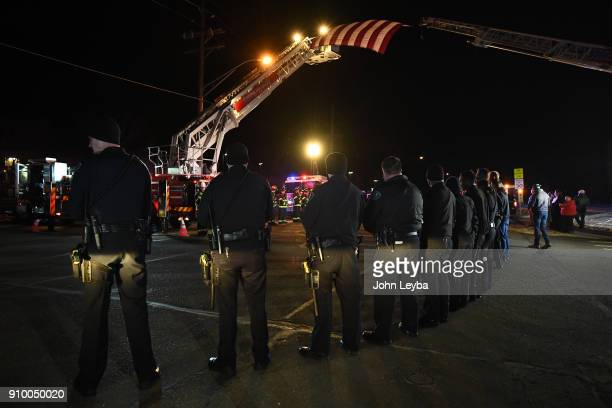 Brighton PD all gathered to pay their respects to fallen Adams County Sheriff's deputy A flag hung down from Truck 53 and Tower 51 to form the...