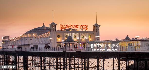 brighton pier as the winter sun starts to set, east sussex, uk - brighton england stock pictures, royalty-free photos & images
