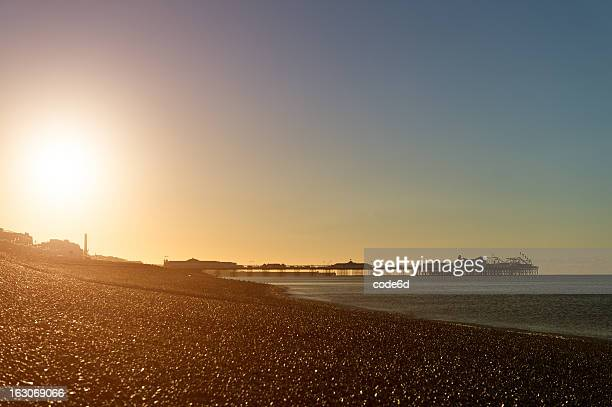 brighton pier at sunrise - brighton beach england stock pictures, royalty-free photos & images