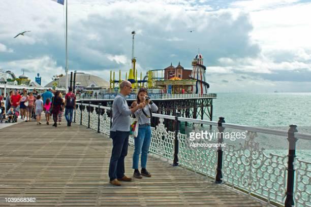 brighton pier - südostengland stock-fotos und bilder