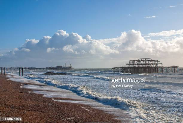 brighton piers & high seas - weather stock pictures, royalty-free photos & images