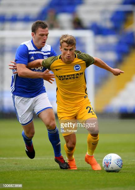 Brighton player Solly March holds off Craig Gardner of Birmingham during the friendly match between Birmingham City and Brighton and Hove Albion at...