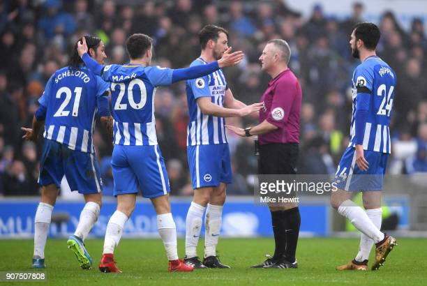 Brighton players appeal to referee Jon Moss during the Premier League match between Brighton and Hove Albion and Chelsea at Amex Stadium on January...