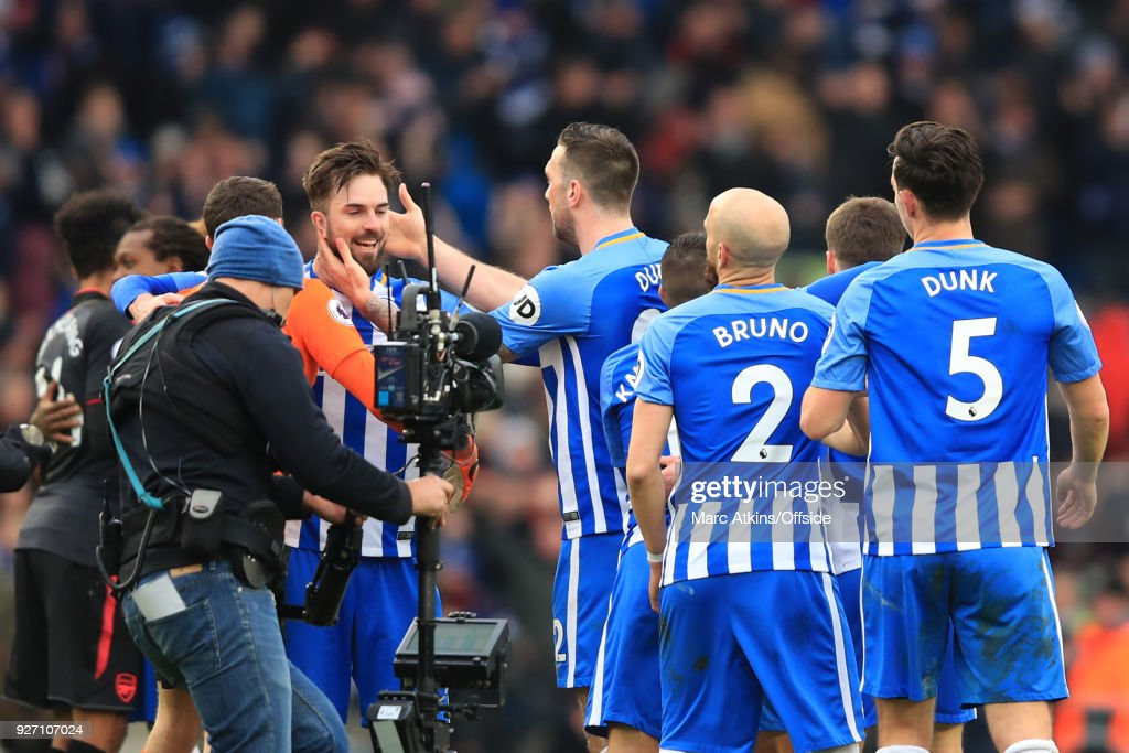 Brighton players celebrate during the Premier League match between Brighton and Hove Albion and Arsenal at Amex Stadium on March 4, 2018 in Brighton, England.