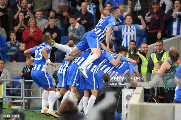 Brighton players celebrate their third goal scored by Tomer Hemed during the Premier League match between Brighton and Hove Albion and West Bromwich...