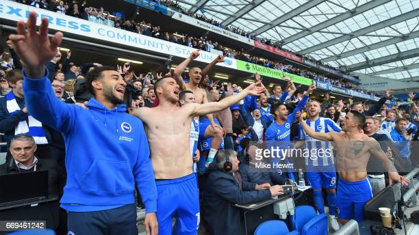 Brighton players celebrate with the fans after the Sky Bet Championship match between Brighton Hove Albion and Wigan Athletic at Amex Stadium on...