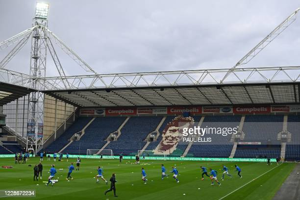 Brighton players warm up in front of the Alan Kelly Stand ahead of the English League Cup third round football match between Preston North End and...