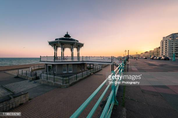 brighton promenade at sunset. - brighton england stock pictures, royalty-free photos & images