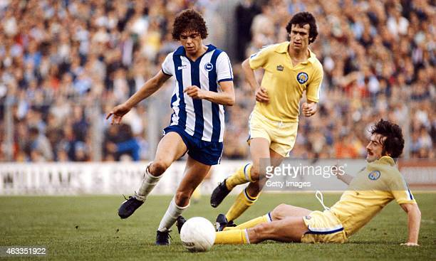 Brighton striker Peter Ward skips the challenge of Leeds player Peter Hampton during a League Division One match between Brighton and Hove Albion...