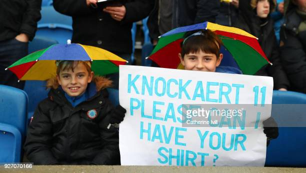 Brighton supporters ask for the shirt of Anthony Knockaert prior to the Premier League match between Brighton and Hove Albion and Arsenal at Amex...
