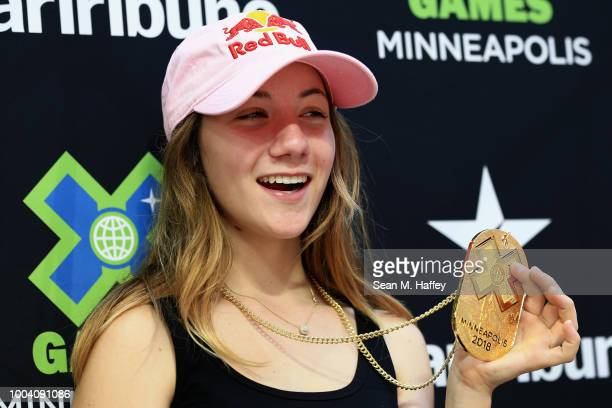 Brighton Zeuner reacts on the podium after finishing first in the Women's Skateboard Park Final during the ESPN X Games at US Bank Stadium on July 22...