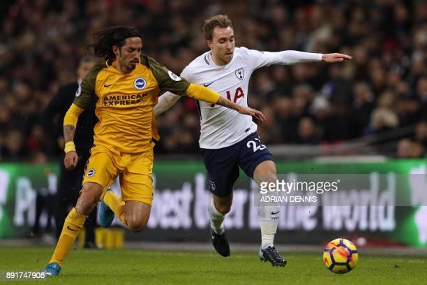 Brighton's Argentineborn Italian defender Ezequiel Schelotto vies with Tottenham Hotspur's Danish midfielder Christian Eriksen during the English...
