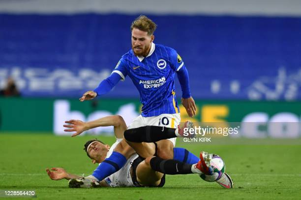 Brighton's Argentinian midfielder Alexis Mac Allister vies for the ball against Portsmouth's English defender James Bolton during the English League...
