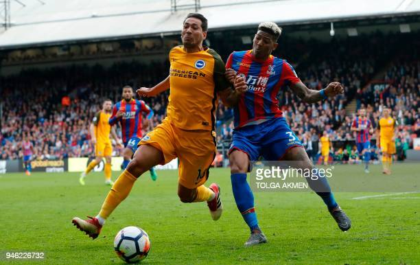 Brighton's Argentinian striker Leonardo Ulloa battles with Crystal Palace's Dutch defender Patrick van Aanholt during the English Premier League...