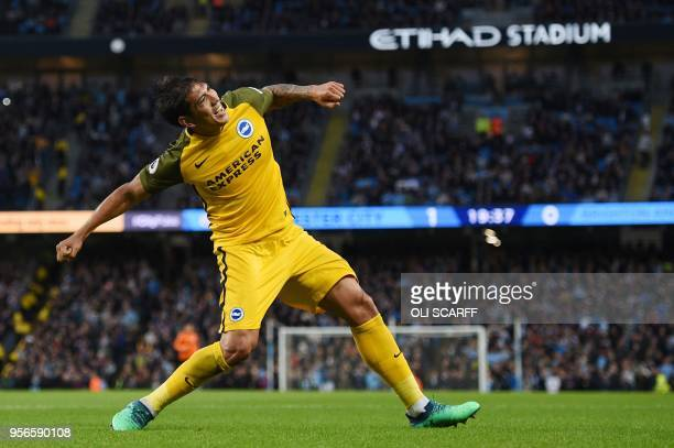 Brighton's Argentinian striker Leonardo Ulloa celebrates after scoring during the English Premier League football match between Manchester City and...