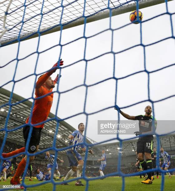 Brighton's Australian goalkeeper Mathew Ryan can only watch as Bournemouth's English defender Steve Cook scores Bournemouth's first goal during the...