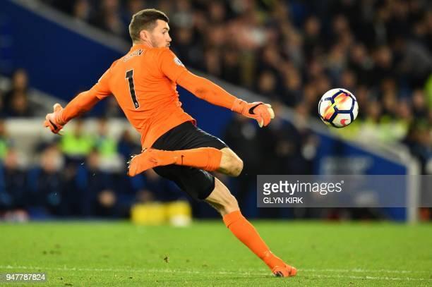 Brighton's Australian goalkeeper Mathew Ryan kicks the ball during the English Premier League football match between Brighton and Hove Albion and...