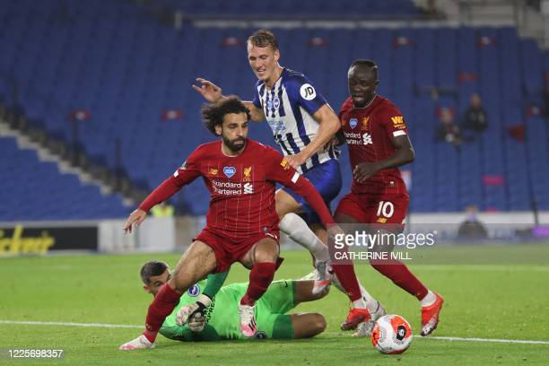 Brighton's Australian goalkeeper Mathew Ryan, Liverpool's Egyptian midfielder Mohamed Salah, Brighton's English defender Dan Burn and Liverpool's...