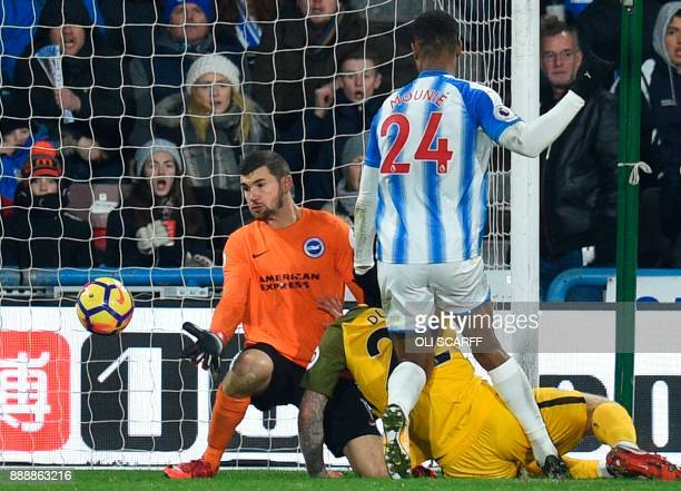 Brighton's Australian goalkeeper Mathew Ryan makes a save during the English Premier League football match between Huddersfield Town and Brighton and...
