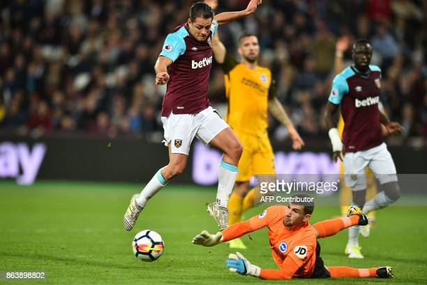 Brighton's Australian goalkeeper Mathew Ryan saves at the feet of West Ham United's Mexican striker Javier Hernandez during the English Premier...
