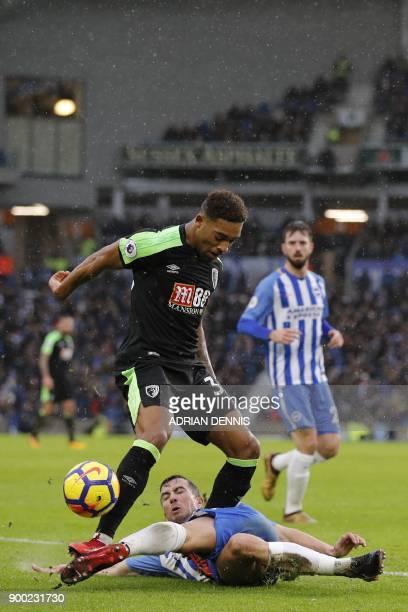 Brighton's Austrian defender Markus Suttner slides in to make a tackle on Bournemouth's English midfielder Jordon Ibe during the English Premier...
