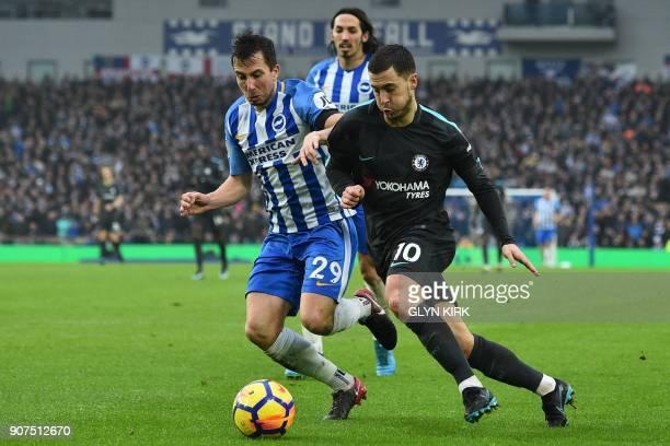 Brighton's Austrian defender Markus Suttner vies with Chelsea's Belgian midfielder Eden Hazard during the English Premier League football match...