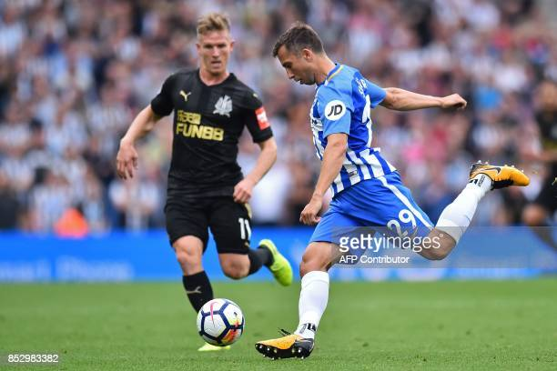 Brighton's Austrian defender Markus Suttner vies with Newcastle United's Scottish midfielder Matt Ritchie during the English Premier League football...