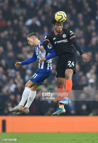 Brighton's Belgian midfielder Leandro Trossard jumps for a header with Chelsea's English defender Reece James during the English Premier League...
