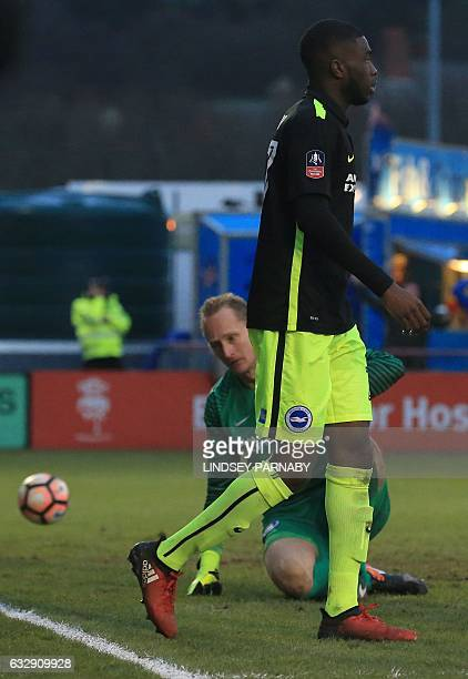 Brighton's Canadianborn English Fikayo Tomori reacts after scoring an own goal making the score 21 to Lincoln during the English FA Cup fourth round...