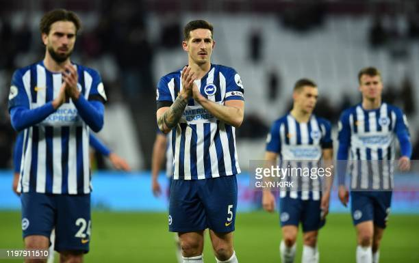 Brighton's Dutch midfielder Davy Propper and Brighton's English defender Lewis Dunk applauds the fans following the English Premier League football...