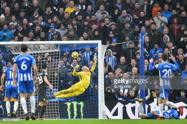Brighton's Dutch midfielder Davy Propper hits the post with a diving header during the English Premier League football match between Brighton and...