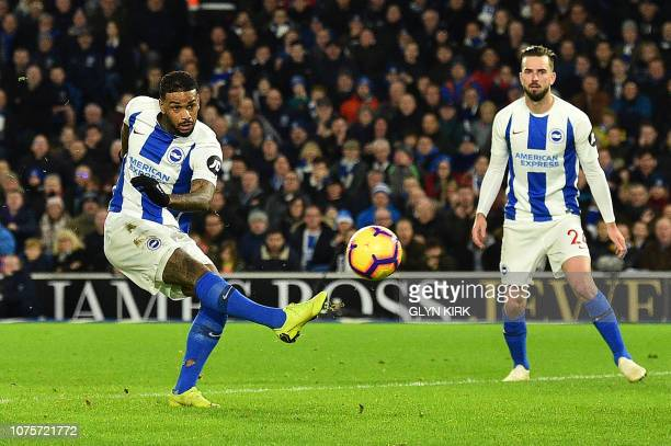 Brighton's Dutch striker Jurgen Locadia scores the opening goal during the English Premier League football match between Brighton and Hove Albion and...