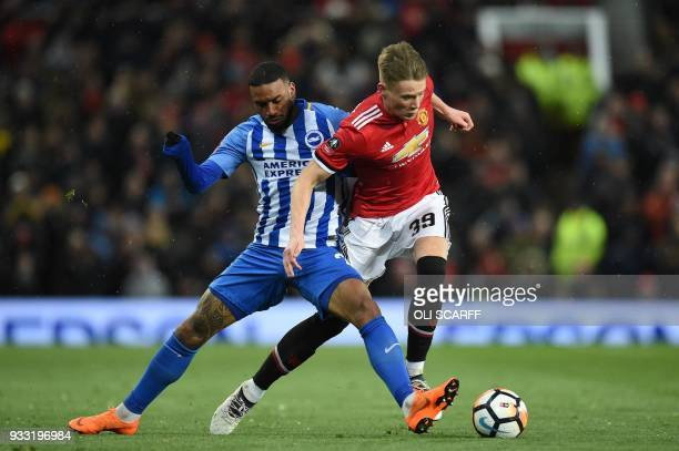 Brighton's Dutch striker Jurgen Locadia tackles Manchester United's English midfielder Scott McTominay during the English FA Cup quarterfinal...