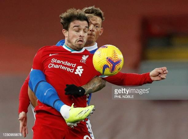 Brighton's English defender Ben White vies with Liverpool's Swiss midfielder Xherdan Shaqiri during the English Premier League football match between...