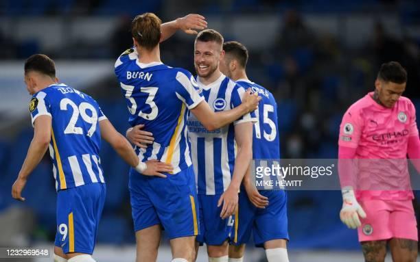 Brighton's English defender Dan Burn celebrates scoring his team's third goal with Brighton's English defender Adam Webster during the English...