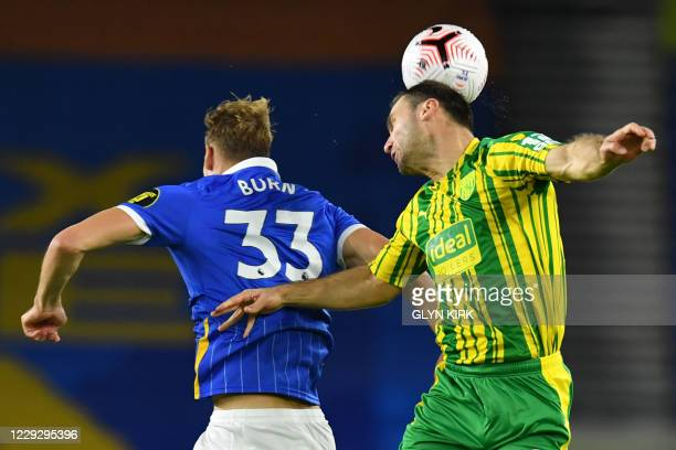 Brighton's English defender Dan Burn vies with West Bromwich Albion's Serbian defender Branislav Ivanovic during the English Premier League football...