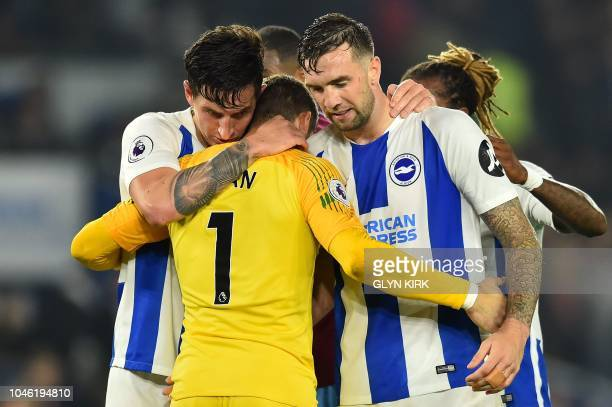 Brighton's English defender Lewis Dunk, , Brighton's Australian goalkeeper Mathew Ryan and Brighton's Irish defender Shane Duffy react after the...
