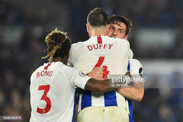 Brighton's English defender Lewis Dunk Brighton's Irish defender Shane Duffy and Brighton's Cameroonian defender Gaetan Bong react after the English...