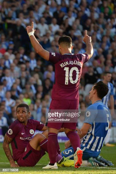 Brighton's English defender Lewis Dunk reacts after scoring an own goal as Manchester City's Argentinian striker Sergio Aguero and Manchester City's...