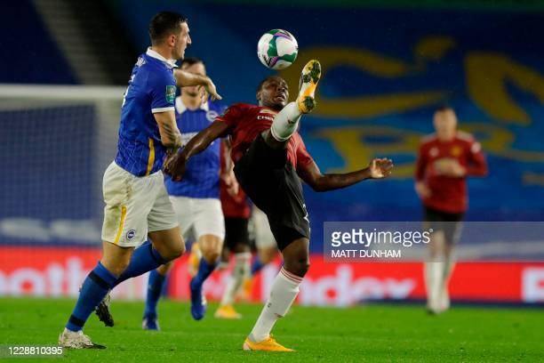 Brighton's English defender Lewis Dunk vies with Manchester United's Nigerian striker Odion Ighalo during the English League Cup fourth round...