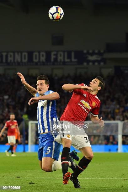 Brighton's English defender Lewis Dunk vies with Manchester United's Italian defender Matteo Darmian during the English Premier League football match...