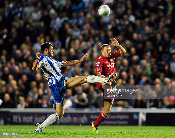 Brighton's English defender Steve Cook vies with Liverpool's Welsh striker Craig Bellamy during the 3rd round league cup football match between...