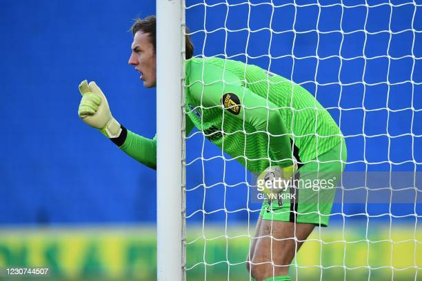 Brighton's English goalkeeper Christian Walton gestures during the English FA Cup fourth round football match between Brighton and Hove Albion and...