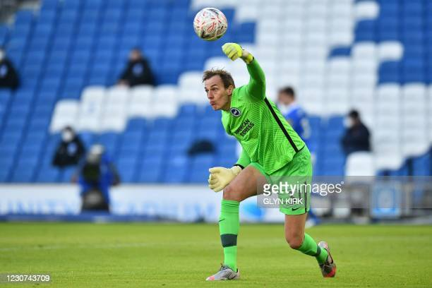 Brighton's English goalkeeper Christian Walton throws the ball out during the English FA Cup fourth round football match between Brighton and Hove...