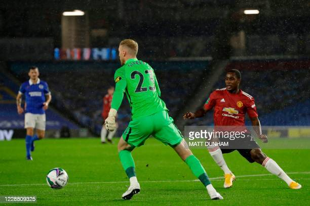Brighton's English goalkeeper Jason Steele (L0 takes the ball around Manchester United's Nigerian striker Odion Ighalo during the English League Cup...