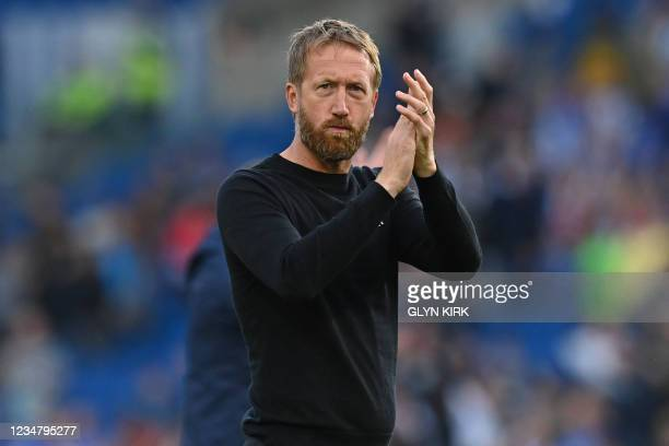 Brighton's English manager Graham Potter applauds supporters after the English Premier League football match hton's English manager Graham...