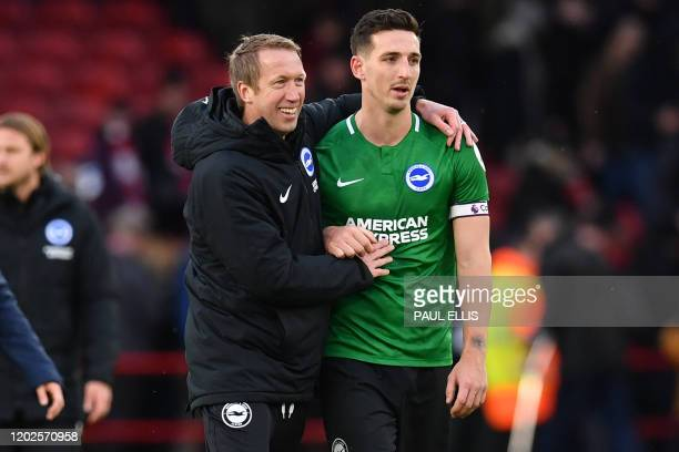 Brighton's English manager Graham Potter congratulates Brighton's English defender Lewis Dunk on the pitch after the English Premier League football...