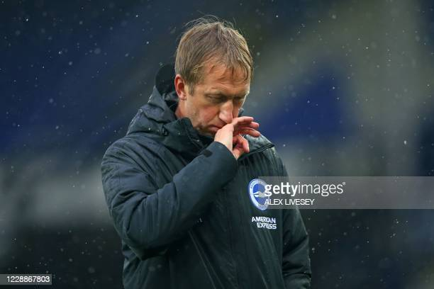 Brighton's English manager Graham Potter reacts to their defeat on the pitch afterg the English Premier League football match between Everton and...