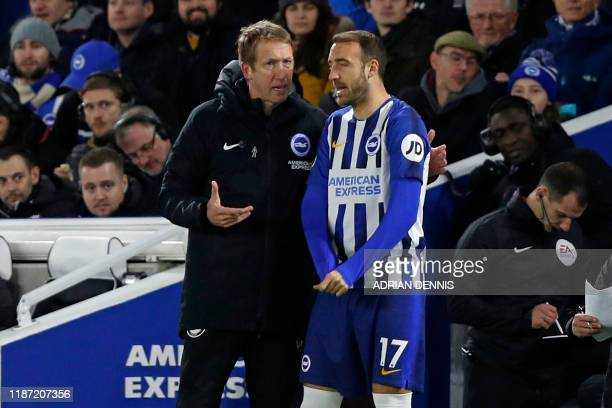 Brighton's English manager Graham Potter speaks with Brighton's English striker Glenn Murray on the touchline during the English Premier League...