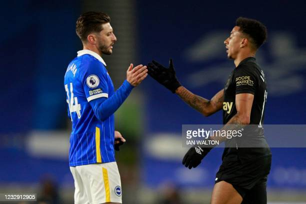 Brighton's English midfielder Adam Lallana and West Ham United's English midfielder Jesse Lingard shake hands on the final whistle in the English...